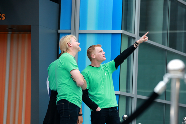 Apple employees in green shirts at iPhone 5 launch event