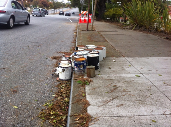 People Behaving Badly in San Francisco dumping buckets of paint next to the road