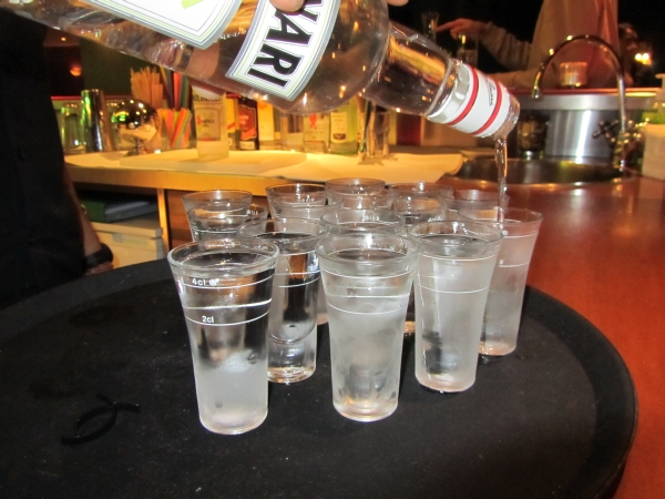 Pooring Sambuca into shot glasses