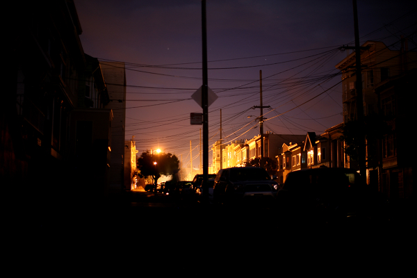 Power outage in San Francisco Inner Richmond district. Blacked-out street, while other block has electricity